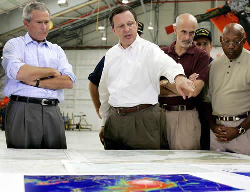 Jim Watson/Getty Images. FEMA Director Michael Brown explains Katrina situation to President George W. Bush and Homeland Security Secretary Michael Chertoff