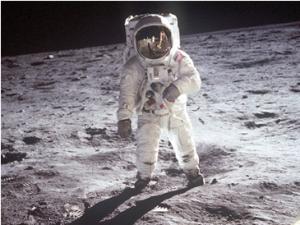 Buzz Aldrin takes a stroll on the moon, partly thanks to John Kennedy. NASA