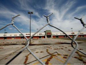 A vacant strip mall. Photo by Gerald Herbert, AP.