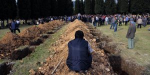 Graves dug for dead miners at a mass burial site in Soma.