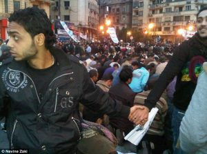 Christians protecting Muslims in Tahrir Square, 2011