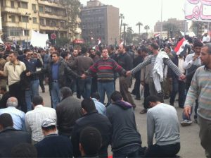 Christians protecting Muslims in Tahrir Square, 2011.