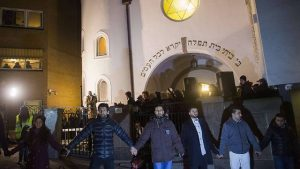 Muslims form a shield in front of a synagogue in Norway.