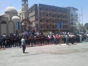 Muslims pray in front of a Coptic church in an act of solidarity.