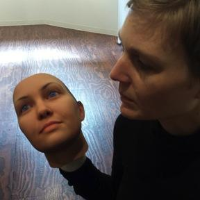 Heather Dewey-Hagborg contemplates her own face, created from DNA she extracted from a strand of her hair.