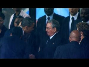 President Obama shakes hands with Raul Castro at Nelson Mandela's memorial.