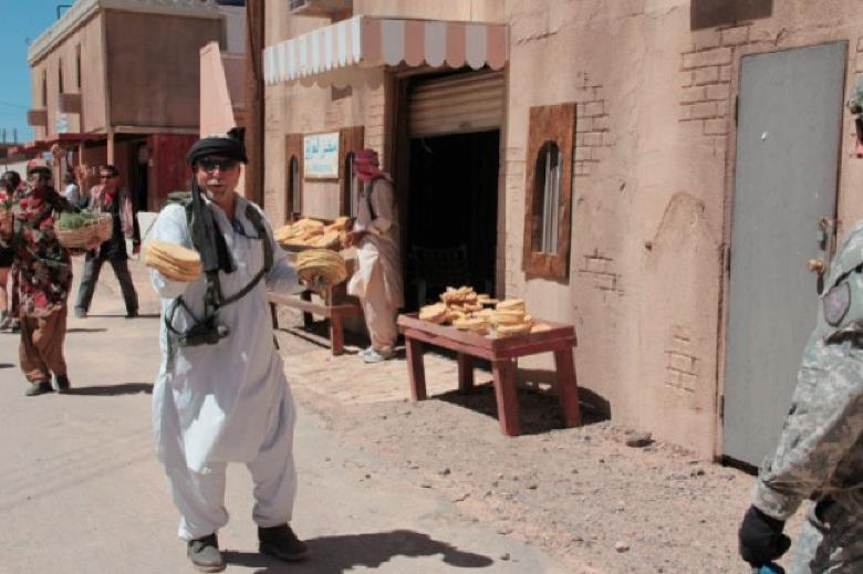 Mock Middle Eastern town set up in Ft. Irwin, VA, with actors.