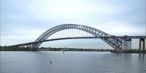 The Bayonne Bridge spans the waterway linking New Jersey with Staten Island, a site that remains radioactive today. Photo credit: Raymond Bucko, SJ / Flickr