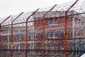 Razor wire fence surrounding inmate housing at Riker's Island.
