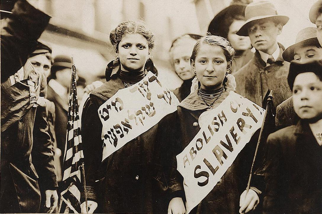 "This photograph, probably from a 1909 labor parade in NYC, shows two children wearing sashes that say ""Abolish Child Slavery!!"" in English and Yiddish. It wasn't until the 1938 Fair Labor Standards Act passed that child labor laws were put into effect at the national level permanently, though to this day such protections don't extend to many of the 500,000 children working in the agricultural industry in the US. Photo credit: Bain News Service / Library of Congress"
