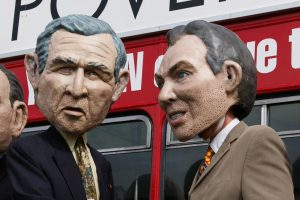 Protesters wearing George W. Bush and Tony Blair disguises. Photo credit: Tintazul / Wikimedia (CC BY 2.0)
