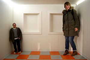 Ames Room illusion. This is not Photoshopped. See explanatory video below. Photo Credit: Ian Stannard / Flickr (CC BY-SA 2.0)