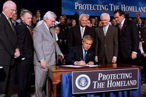 President George W. Bush signed an Executive Order Establishing Office of Homeland Security on October 8, 2001. This photo depicts President Bush signing the Homeland Security Appropriations Act of 2004 at the Department of Homeland Security (DHS) in Washington, DC, Wednesday, Oct. 1, 2003. Photo Credit: Tina Hager / White House / Wikimedia