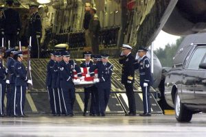The USS Cole was attacked on October 12, 2000. The US Navy guided-missile destroyer was in harbor and being refueled in the Yemeni port of Aden. Al-Qaeda claimed responsibility for the attack. Seventeen American sailors were killed, and 39 were injured. About this photo: A US Air Force honor guard carries the remains of a sailor killed in the attack on the USS Cole from a C-17 Globemaster III at Ramstein Air Base, Germany, on Oct. 13, 2000. Photo Credit: Tech. Sgt. Jerry King / U.S. Air Force / Wikimedia