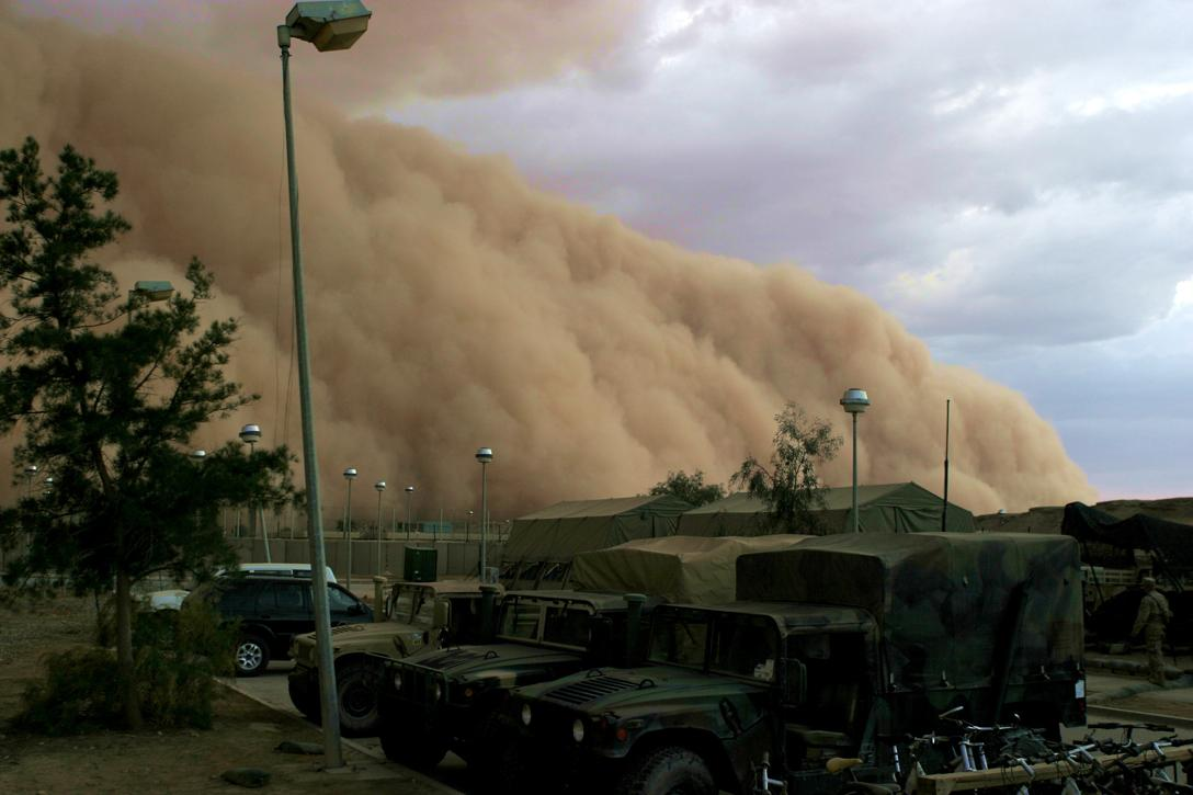 A massive sand storm cloud is close to enveloping a military camp as it rolls over Al Asad, Iraq. Photo credit: US Marine Corps