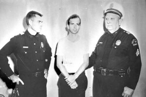Lee Harvey Oswald and two policemen taken after Oswald's arrest. Photo credit: ARCHIVES.GOV.