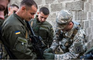 US military advisers will start training six battalions of the Ukrainian Armed Forces on November 23, Ukrainian Presidential Administration spokesman Andriy Lysenko said Saturday. About this photo: US Army Sgt. with Ukrainian National Guard soldiers. Photo Credit: US Army