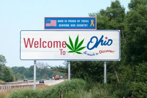 Ohio will decide the fate of legal weed today. Photo Credit: Adapted by WhoWhatWhy from Ohio Sign (bearclau / Flickr [CC BY 2.0]) and Cannabis leaf (Oren neu dag / Wikimedia [CC BY-SA 3.0])