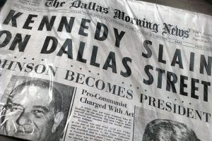 Kennedy slain on Dallas street November 23, 1963 — paper re-published on plastic bag. Photo credit: Grant Laird Jr / Flickr (CC BY 2.0)