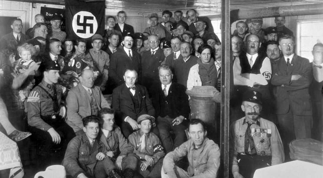 Adolf Hitler with Nazi Party members in 1930