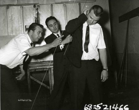 LAPD criminalist Dewayne Wolfer (left) and L.A. County Coroner Dr. Thomas Noguchi (center) trace the trajectories of the bullets fired at Robert F. Kennedy Photo credit: California State Archives