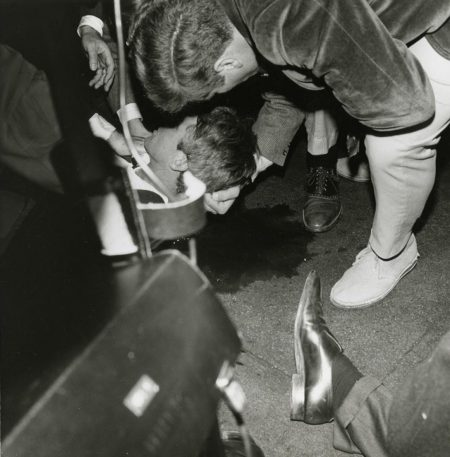 Robert F. Kennedy on the floor of the Ambassador Hotel pantry after the shooting. Paul Schrade's shoe can be seen in the foreground. Photo credit: California State Archives