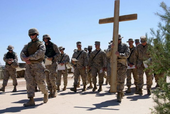 Soldiers carrying cross