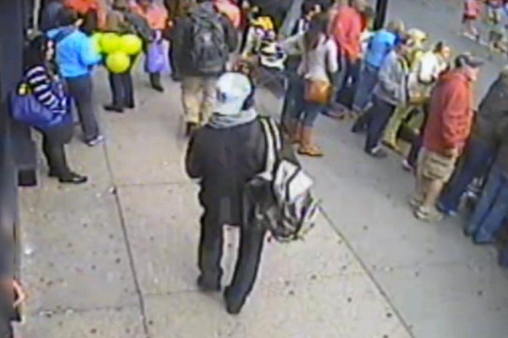 Dzhokhar Tsarnaev walking with backpack