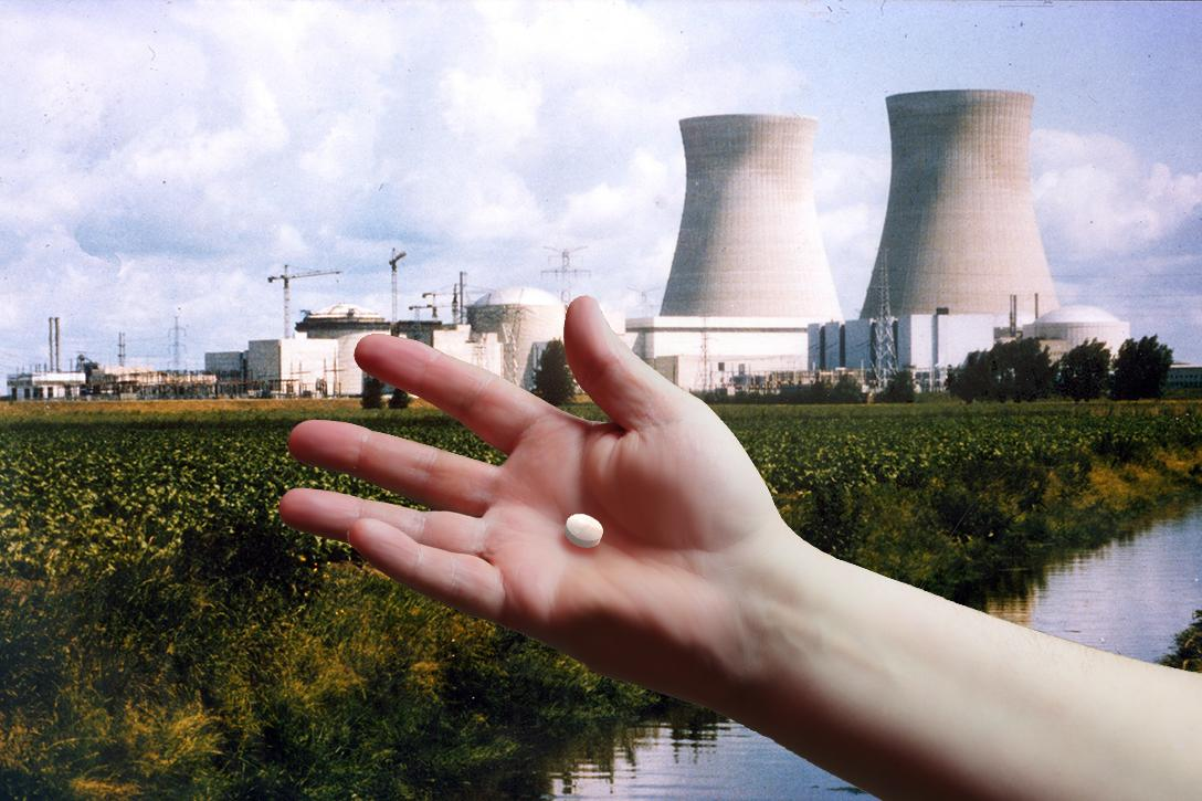Doel nuclear plant, Belgium, hand, pill