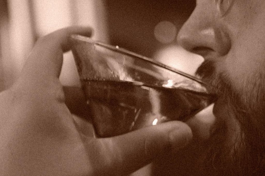 Man Drinking Cocktail