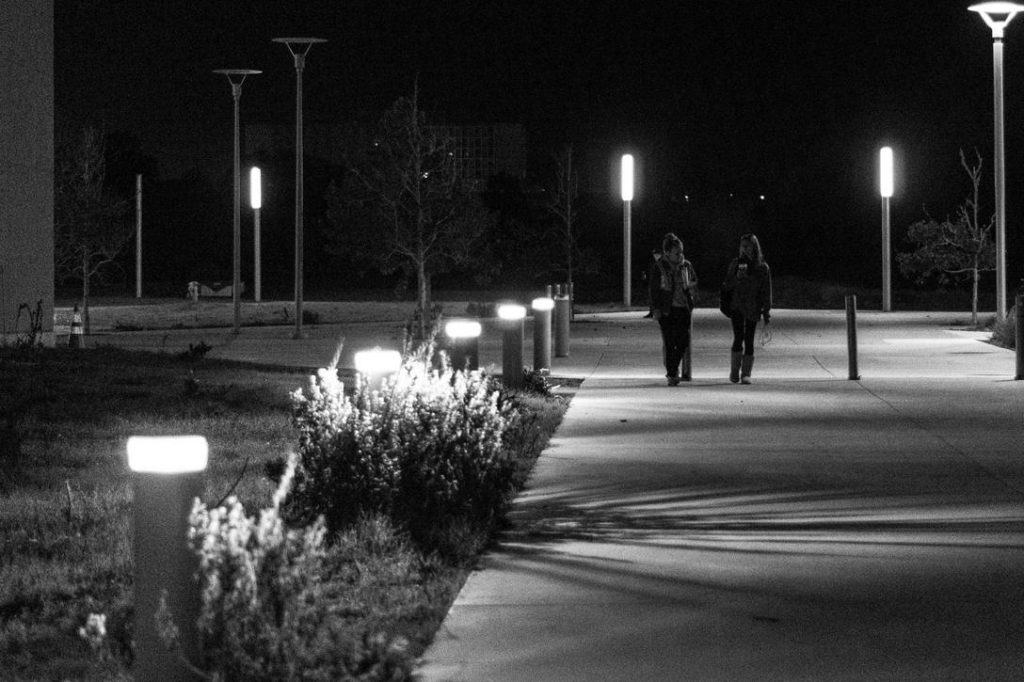 Women on campus at night.