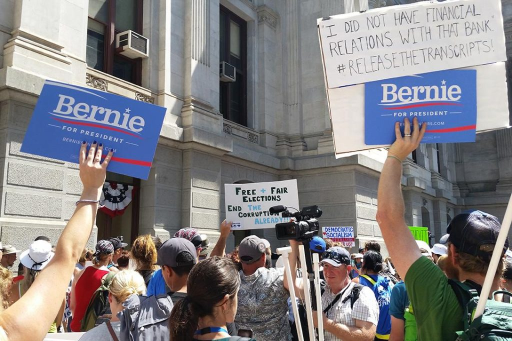 Bernie Sanders supporters rally at the Democratic National Convention. Photo credit: Jon Hecht / WhoWhatWhy