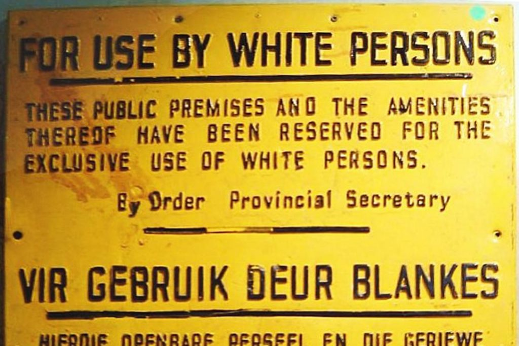 Sign from the Apartheid era in South Africa. Photo credit: Dewet / Wikimedia (cropped)