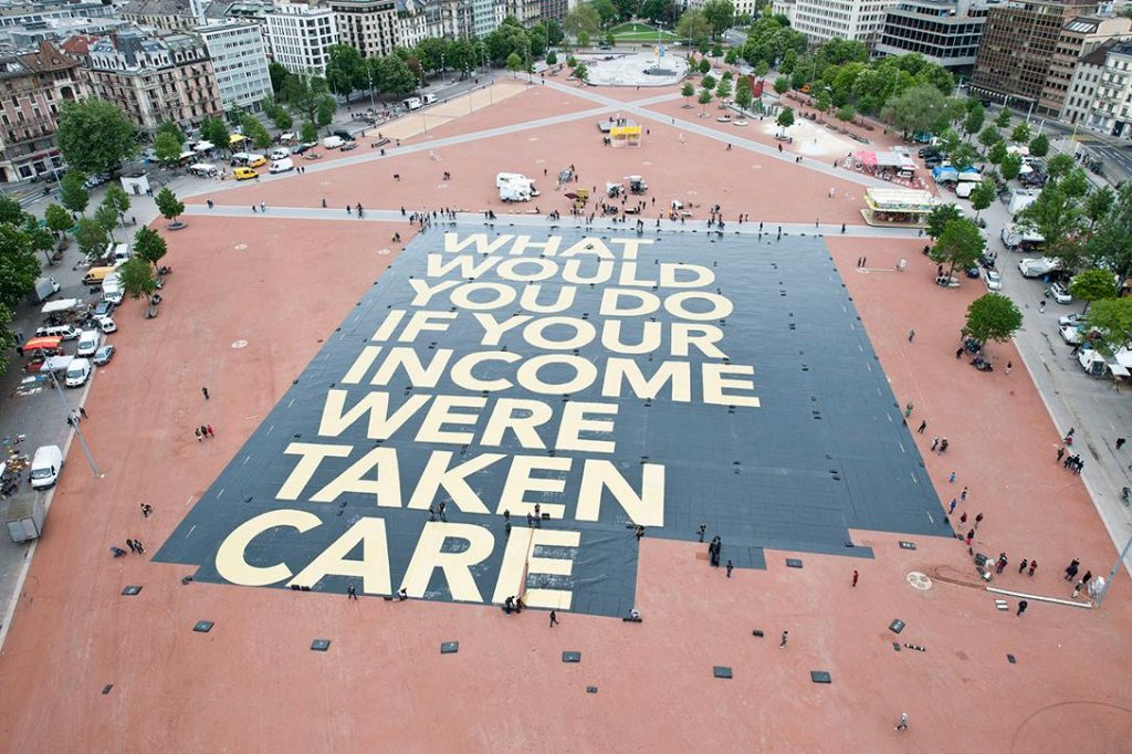 """World's largest poster"" promoting basic income. Photo credit: Generation Grundeinkommen / Flickr (CC BY 2.0)"