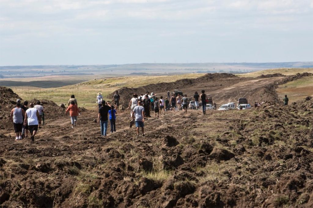 Dakota Access Pipeline protesters on bulldozed land. Photo credit: With permission from Paula Bard