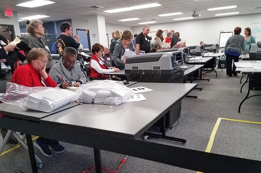 Counting absentee ballots at Waukesha Administration Center, Waukesha, WI. Photo credit: Michael Bacos for WhoWhatWhy