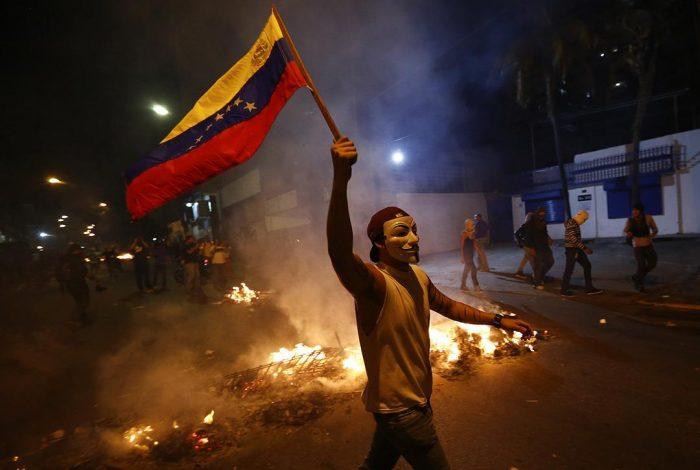 Tens of thousands pour into Venezuela streets