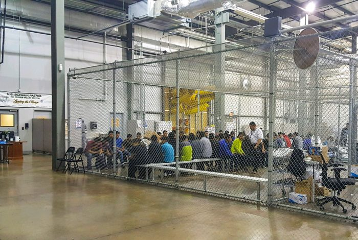 immigrants, cages