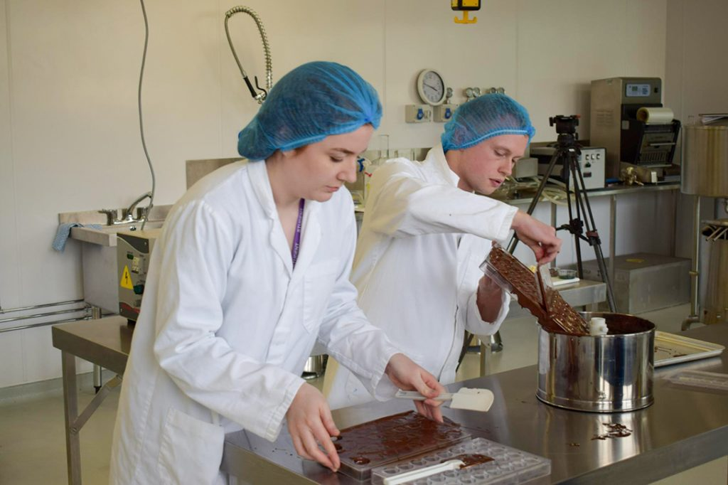 Abertay students, making chocolate