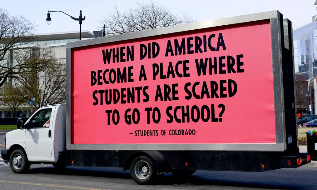 truck, gun, protest sign