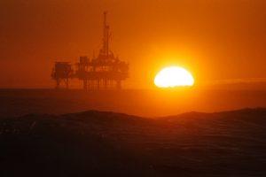 Sunset over oil rig off Huntington Beach, California