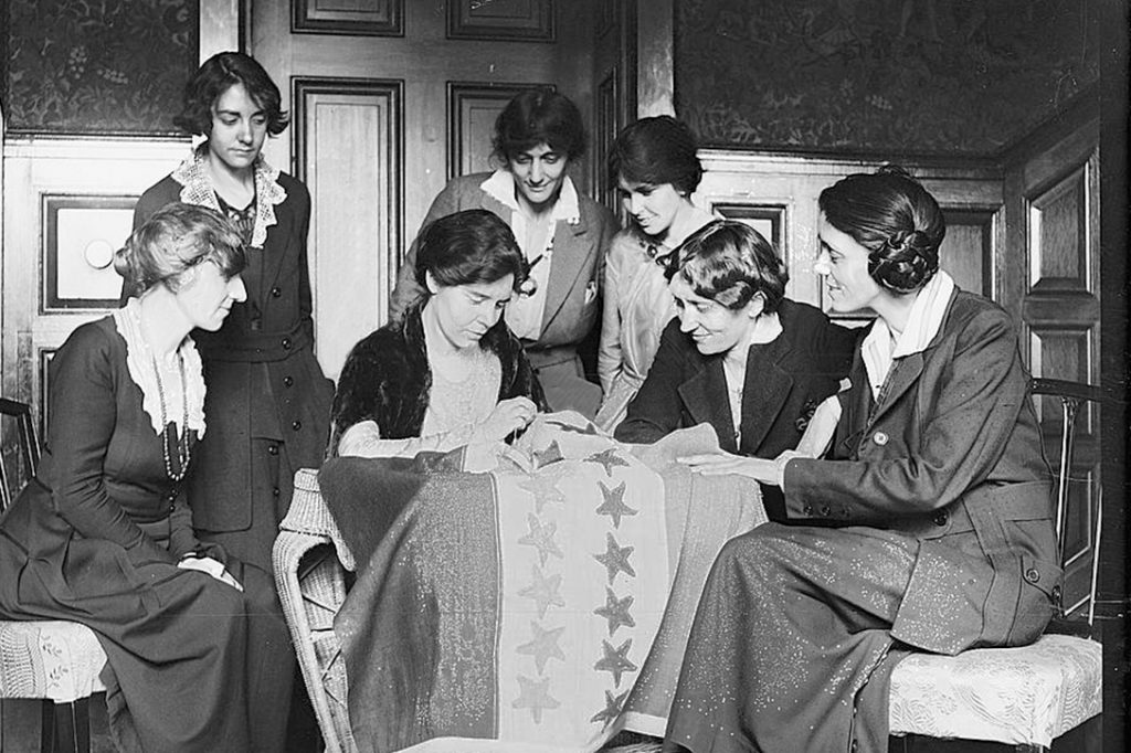 women, sewing, suffrage flag