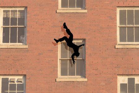 man falling from window