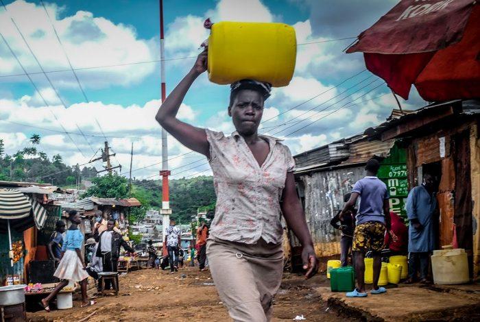 woman, Nairobi, Kenya, poverty, coronavirus