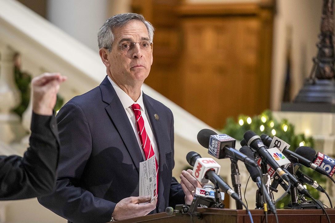 Georgia Secretary of State, Brad Raffensperger, voter registration postcards