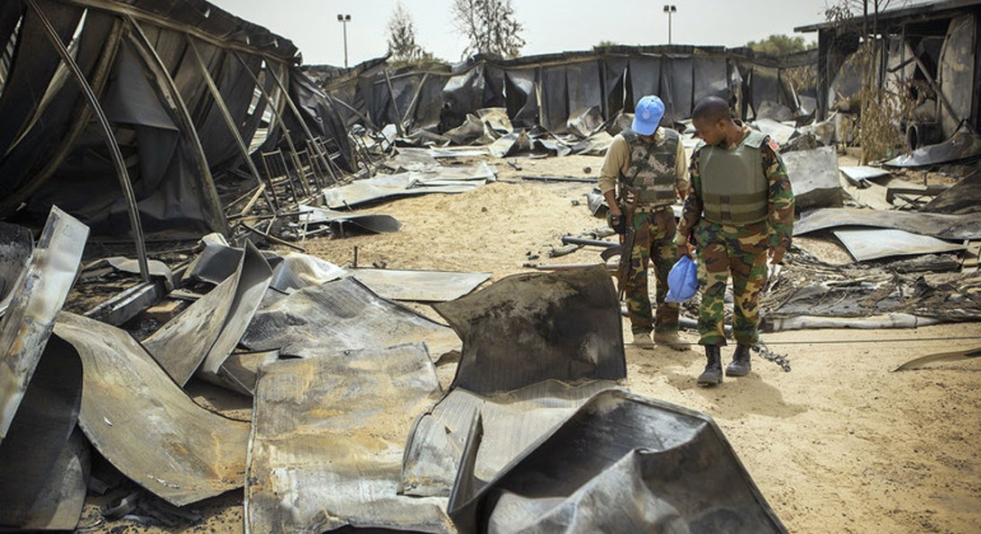 United Nations peacekeeping forces inspecting war damage in Liberia