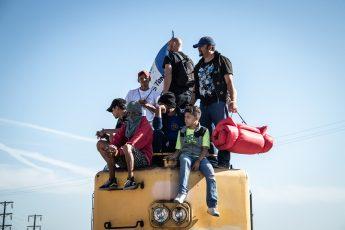 Migrants, Honduras, atop train
