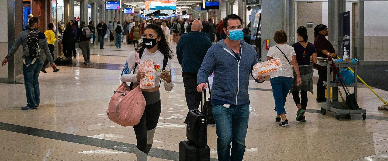 Travelers at Hartsfield-Jackson Atlanta International Airport.