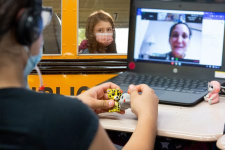 Girl, school bus, COVID-19, remote learning