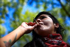 woman smokes cannabis, Mexico City